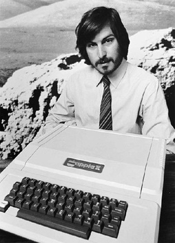 image of Steve Jobs with his Apple II Computer in 1977