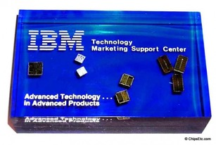 IBM paperweight with the 704 bipolar SAMOS 64k  72k MOSFET Microprocessor computer chips