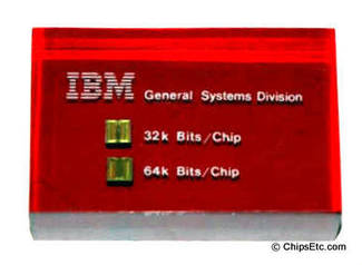 IBM paperweight with a 4300 computer with 32k 64k bit memory chips